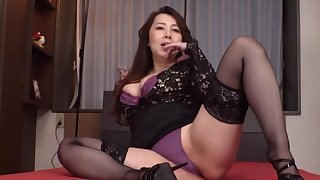 Clothed Japanese mature is attainable to take down her undies